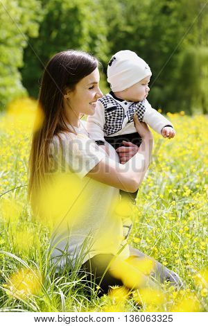 mother playing with her son in a meadow