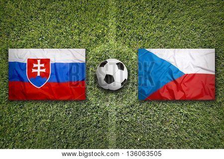 Slovakia Vs. Czech Republic Flags On Soccer Field, 3D Illustration