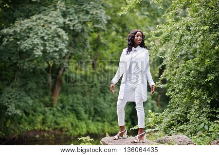 Stylish Black African American Girl Posing At Stone On Park Background River