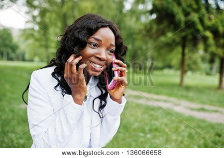 Close Up Portrait Of Stylish Black African American Girl With Pink Mobile Phone