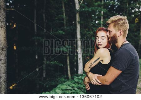 guy hugging his girlfriend from the back