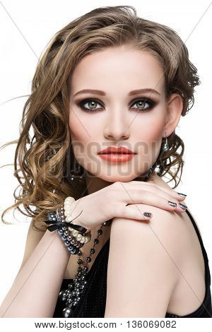 Beautiful young woman with makeup and pearl accessories. Beauty shot. Isolated over white background.