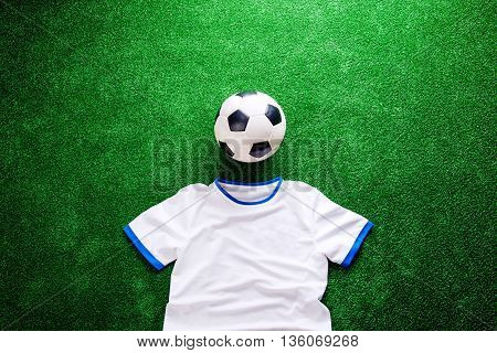 Soccer Ball And White T-shirt Against Artificial Turf