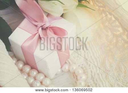 white fresh rose with lace and gift box, retro toned