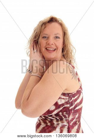 A portrait image of a happy blond woman standing with her hands on her head smiling isolated for white background.