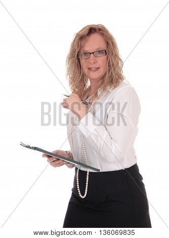 A business woman standing in a black skirt white blouse holding her clipboard looking into the camera isolated for white background.