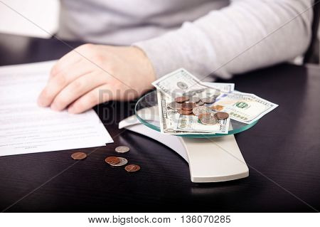Business adviser analyzing financial figures denoting  progress in the work of the company.