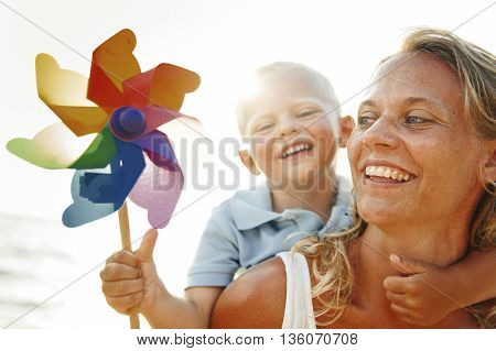 Mother and Son having fun on the beach Concept