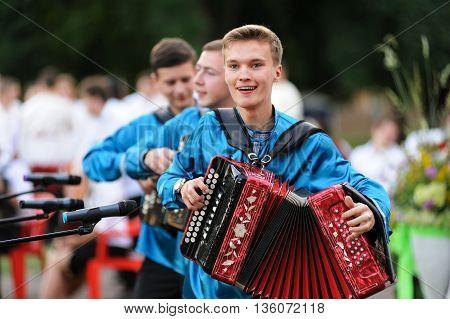 Orel Russia - June 24 2016: Turgenev Fest. Boys in Russian shirts playing accordions horizontal