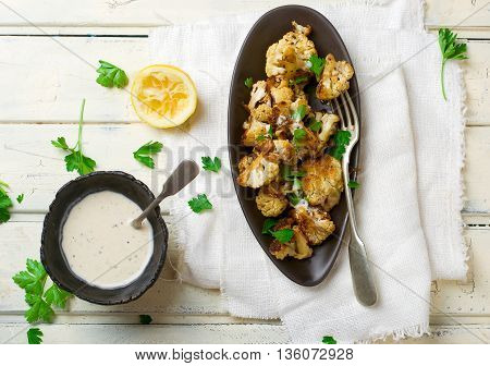 the baked cauliflower with sauce. top view. selective focus