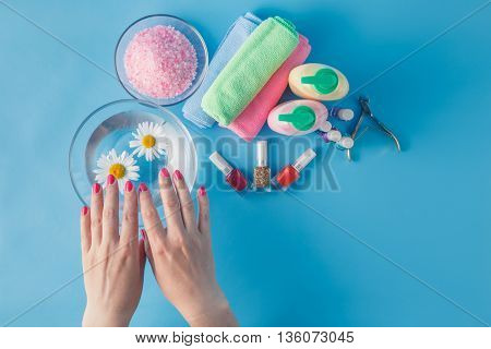 Beautiful Woman's Hands With Perfect Manicure In Bowl Of Water