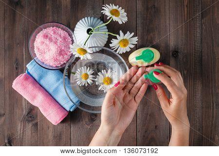 Female Hands Using Dispenser With Liquid Soap