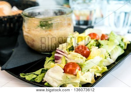 Fresh salad - Delicious fresh salad with tomatoes, lettuce, eggplant, zucchini, cheese, parma ham and olive oil.