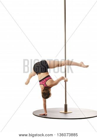 Studio photo of flexible female athlete training on pylon