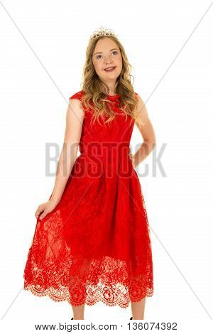 A woman with down syndrome in her pretty red dress wearing a crown on her head with a smile.