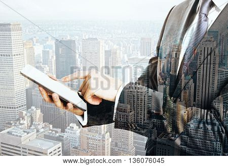Businessman using smartphone on New York city background. Mock up Double exposure