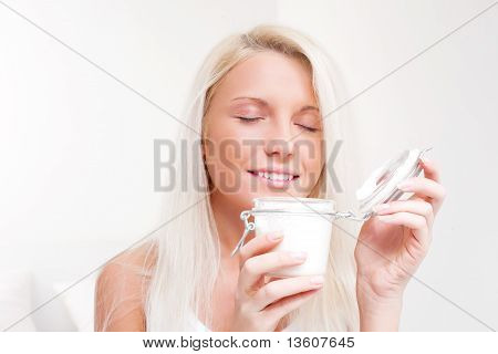 Woman Applying Lotion