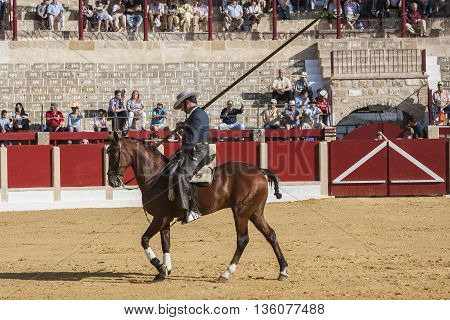 Ubeda SPAIN - September 29 2011: Alvaro Montes bullfighter on horseback spanish witch garrocha (blunt lance used on ranches) Ubeda Jaen province Andalusia Spain