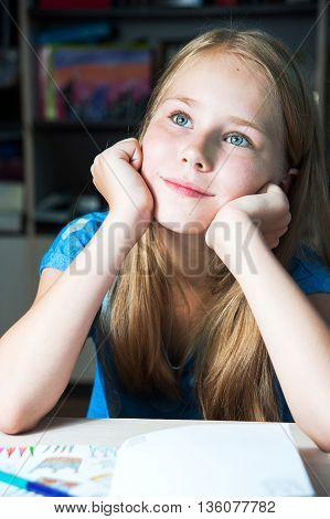 closeup image of a dreaming beautiful little blond girl