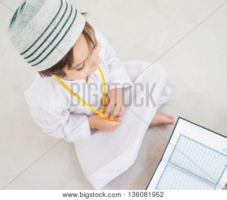 Little kid reading Koran