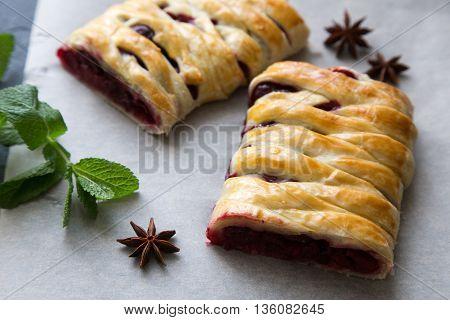 delicious homemade cherry pie. braided pie sliced.