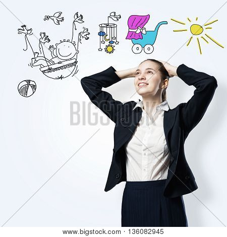 Young woman thinking and dreaming about her future family