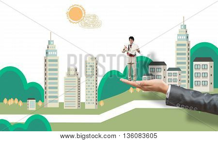 Big female palm holding small confident businessman playing drums