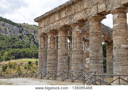 Doric pillars of ancient Greek temple in Segesta Sicily archeological site in the Mediterranean in countryside settings