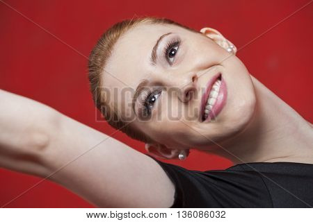 Happy Ballet Dancer Practicing Against Red Wall