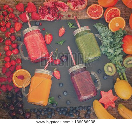 Fresh smoothy drinks in glass jars with igredients, retro toned