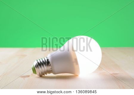 Led Lamp Lying On A Wooden Table