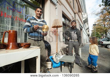 ZAGREB, CROATIA - OCTOBER 17, 2013: Roma family collecting waste at street garbage dump.