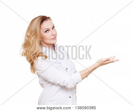 Cheerful caucasian lady showing something isolated at white background. Blond middle-aged attractive woman looking at camera, pointing at nowhere with copy space