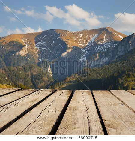 Mountain Landscape And Empty Wooden Deck Table. Ready For Product Montage Display