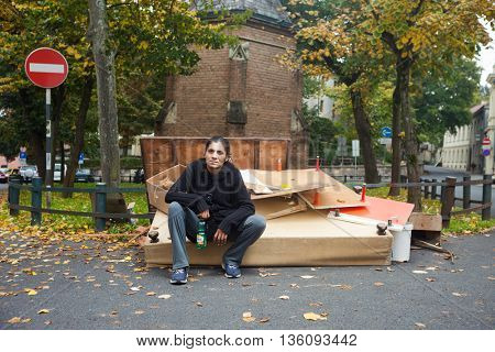 ZAGREB, CROATIA - OCTOBER 14, 2013: Roma woman sitting at the garbage dump.
