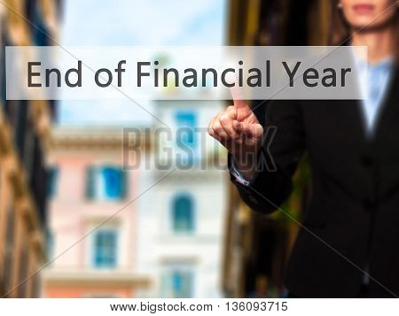End Of Financial Year - Businesswoman Hand Pressing Button On Touch Screen Interface.