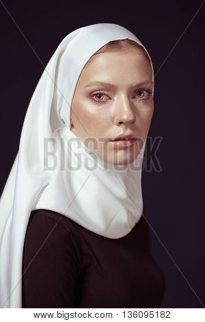 Young Religious Woman In A White Shawl