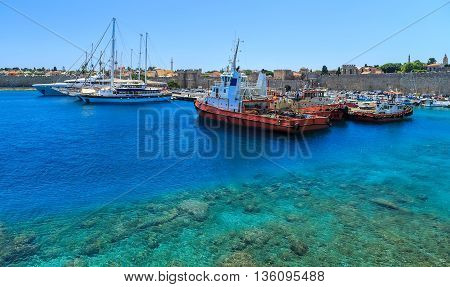 port of Rhodes with views of the ramparts Greece sunny day