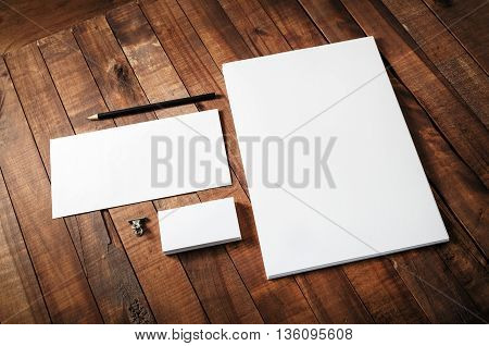 Blank corporate identity template on wooden table background. Blank template for design portfolios. Mock-up for your design. Blank stationery set.