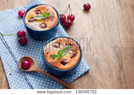 Cheese casserole with cherries on wooden background