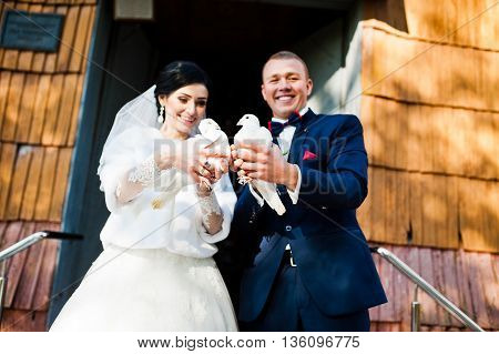 Wedding Couple With Doves At They Hand