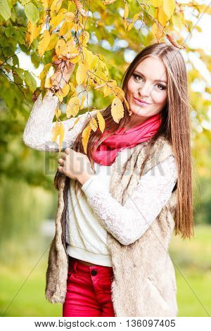 Fall lifestyle concept harmony freedom. Attractive young woman fashion girl long hair relaxing walking in autumnal park outdoor