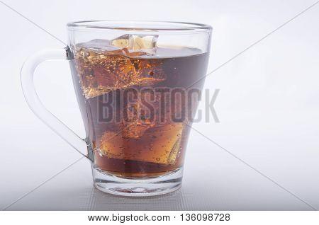 cool drink in a glass glass on a white background