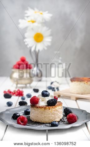 Ukrainian cheesecake with berries and cream still life