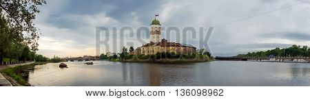 Panorama of ancient white castle of Vyborg was founded by Swedes in 1293, during the Third crusade to the Karelian land, an ally of Novgorod the Great. Old historical building under UNESCO protection.