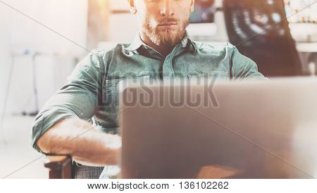 Bearded Style Businessman work Laptop modern Design Interior Loft Studio Place.Man chilling Vintage chair.Use contemporary Notebook, blurred background.Creative Process New Startup Idea.Film effect