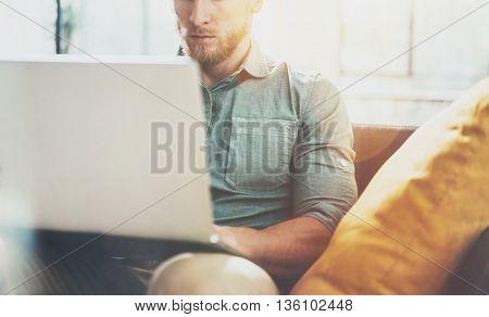 Portrait Bearded Businessman work Laptop modern Design Interior Loft Studio Place.Man relaxing Vintage Sofa.Use contemporary Notebook, blurred background.Creative Process New Startup Idea.Film effect