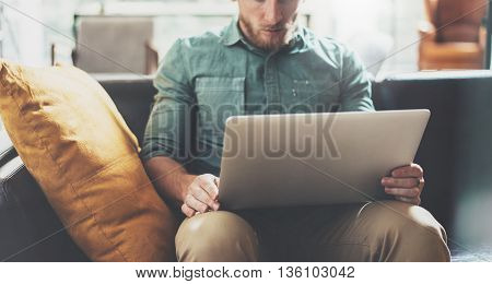 Bearded Style Businessman work Laptop modern Design Interior Loft Studio Office.Men Lounge Vintage Sofa.Use contemporary Notebook, blurred background.Creative Process New Startup Idea.Film effect