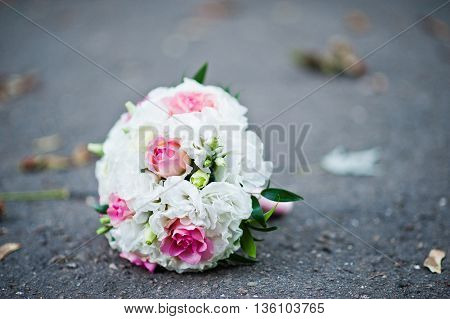 Wedding bouquet on the pavement at wedding