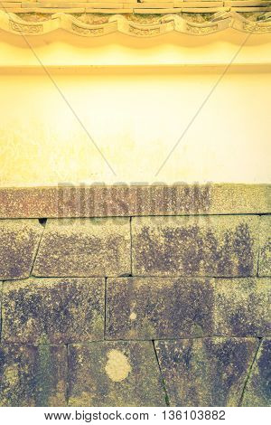 Japan Wall with old tiled roof ,Filtered image processed vintage effect.